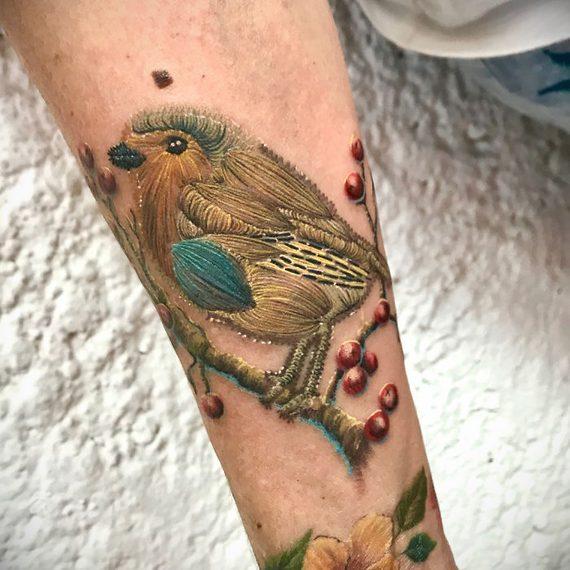 Espectaculares tatuajes que parece auténticos bordados. 7